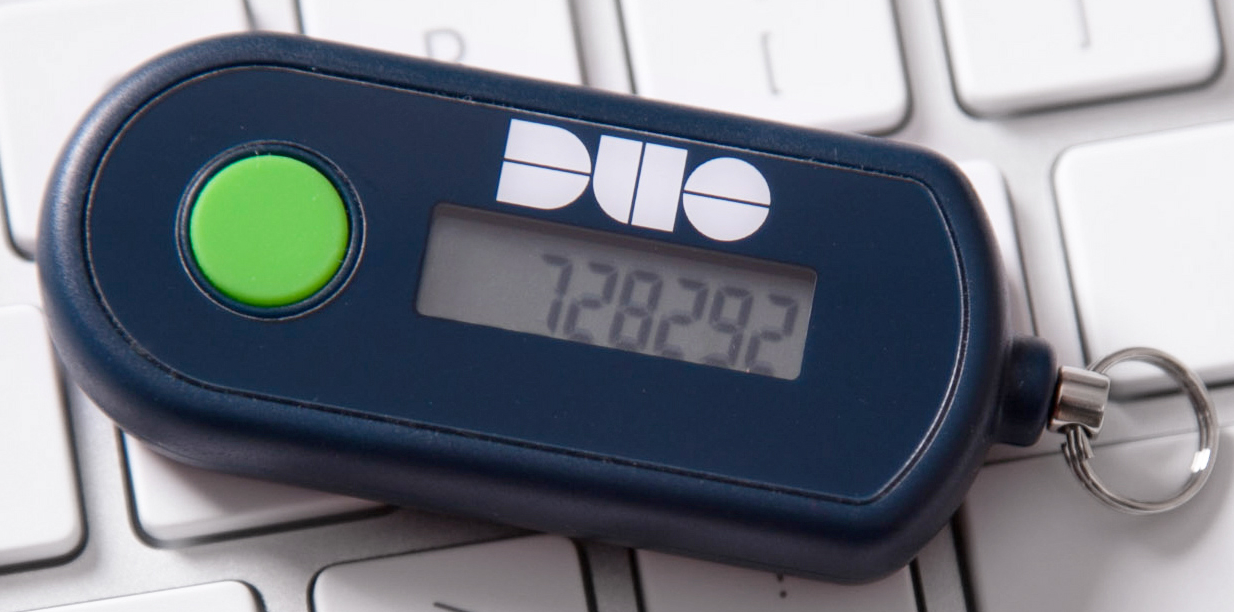 A Duo hardware token is shown.  It is displaying a sample passcode.