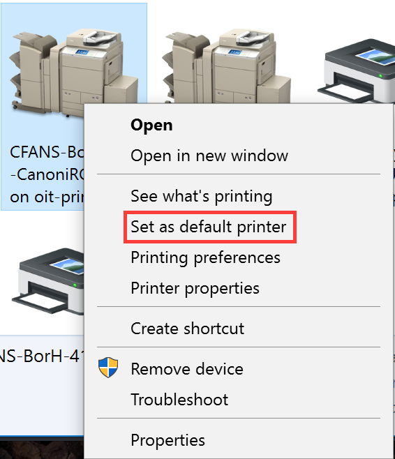 """A printer is selected in the background. The right-click context menu is open, and the """"Set as default printer"""" item is highlighted."""