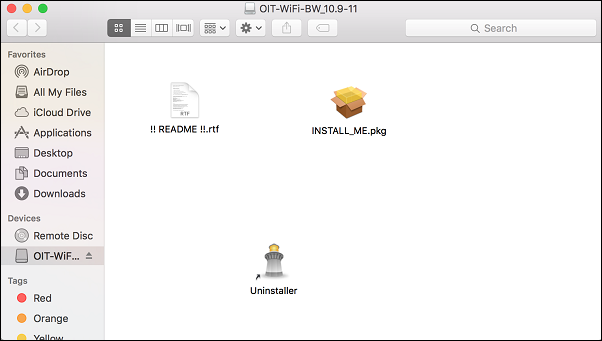 "A Finder window called ""OIT-WiFI-Color_10.9-11"" containing three icons, called ""!! README !!.rtf"", ""INSTALL_ME.pkg"", and ""Uninstaller"". There is a list of Favorites that includes ""AirDrop"", ""All My Files"", ""iCloud Drive"", ""Applications"", ""Desktop"", ""Documents"", and ""Downloads"". A list of Devices includes ""Remote Disk"" and ""OIT-WiF..."". ""OIT-WiF.."" is highlighted. A list of tags includes ""Red"", ""Orange"" and ""Yellow""."
