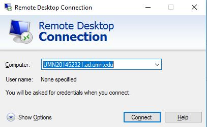 Typing in full computer name into the remote desktop connection application.